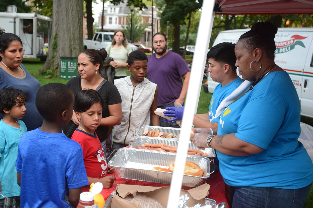 . Free food was a big draw for a National Night Out event at Columbus Park in Trenton Tuesday. 