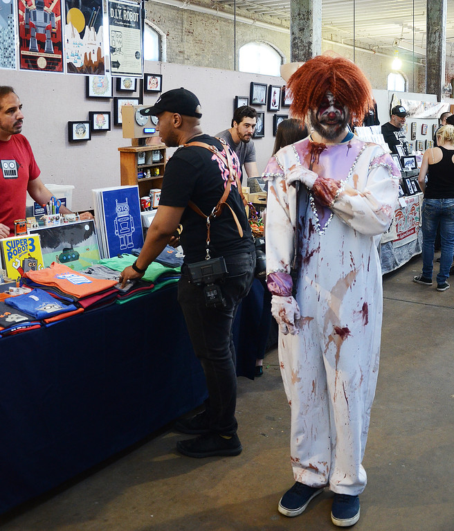 . Rancid the clown (r) haunts the Trenton Punk Rock Flea Market on Saturday. gregg slaboda photo