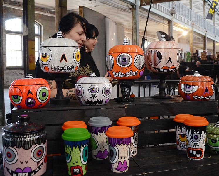People check out the Halloween painted containers at the Trenton Punk Rock Flea on Saturday  . gregg slaboda photo