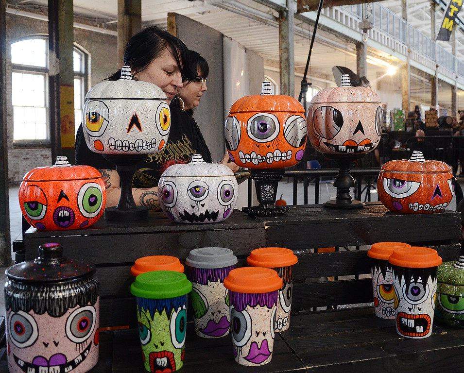 . People check out the Halloween painted containers at the Trenton Punk Rock Flea on Saturday  . gregg slaboda photo