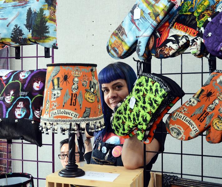 Jeisha(c)peeks trough her spooky handmade decor at the Trenton Punk Rock Flea Market on Saturday. gregg slaboda photo