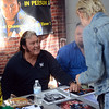 Former pro wrestler The Honky Tonk Man(l)talks with a fan at the Trenton Punk Rock Flea Market on Saturday. gregg slaboda photo
