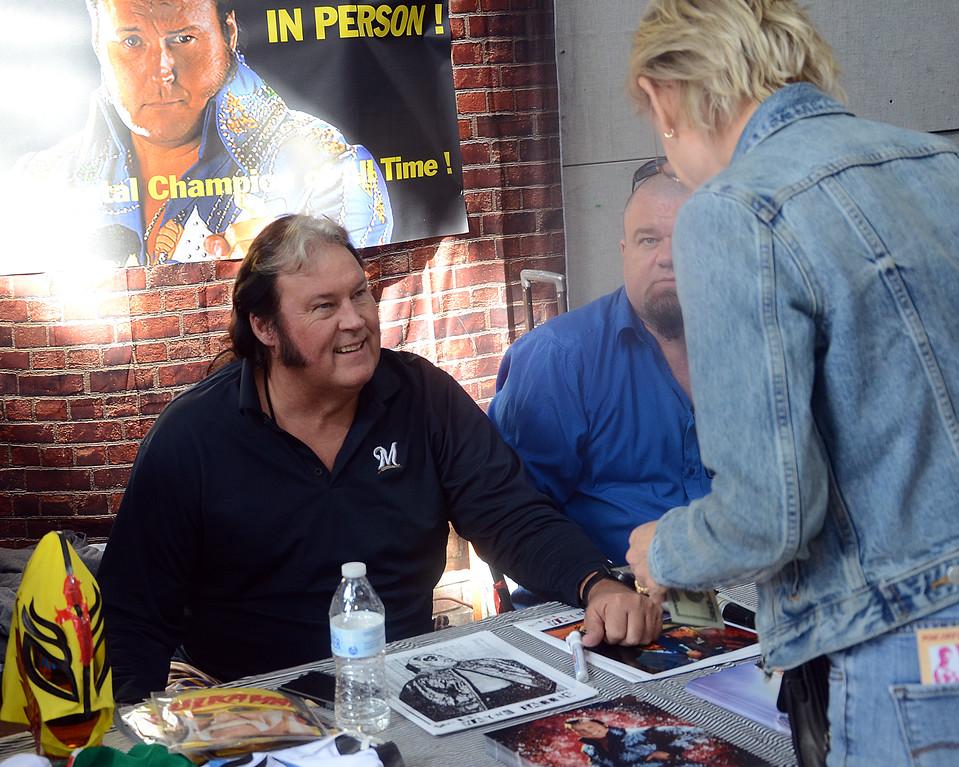 . Former pro wrestler The Honky Tonk Man(l)talks with a fan at the Trenton Punk Rock Flea Market on Saturday. gregg slaboda photo