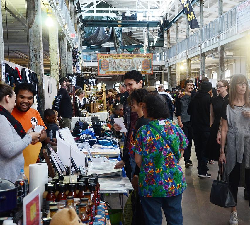 . People check out the Trenton Punk  Rock Flea Market  on Saturday. gregg slaboda photo