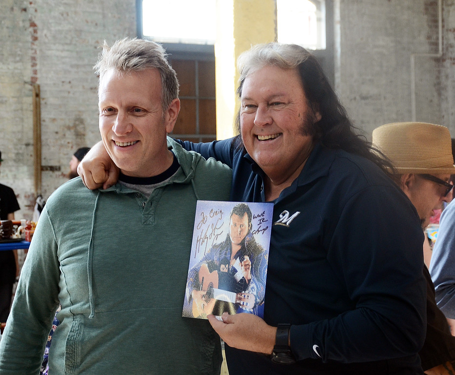 . Former pro wrestler The Honky Tonk Man(r)stands with fan Craig Skinner at the Trenton Punk Rock Flea Market on Saturday. gregg slaboda photo