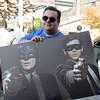 Brian Scott shows off his purchase at the Trenton Punlk Rock Flea Market. gregg slaboda photo