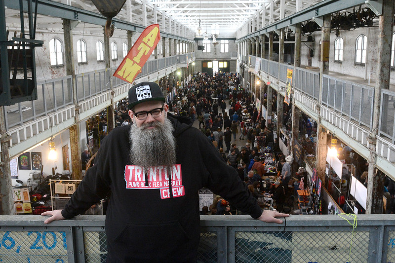 Founder of the Trenton Punk Rock Flea Market Joseph Kuzemka strikes a familiar pose upstairs at the flea market Saturday. <br /> John Berry — The Trentonian