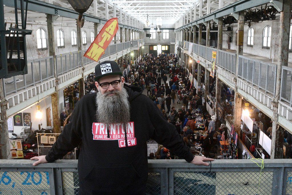 . Founder of the Trenton Punk Rock Flea Market Joseph Kuzemka strikes a familiar pose upstairs at the flea market Saturday. John Berry � The Trentonian