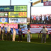 Boy Scouts from Lower Makefield present the colors as Manor Elementary students are shown on the screen singing the National Anthem before Thursday Trenton Thunder game.<br /> John Berry — The Trentonian