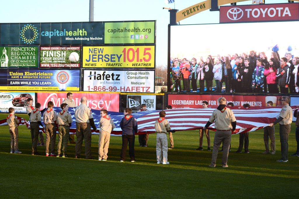 . Boy Scouts from Lower Makefield present the colors as Manor Elementary students are shown on the screen singing the National Anthem before Thursday Trenton Thunder game.