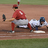 Trenton Thunder's Zack Zehner dives back to first as Altoona Curve's Conner Joe tries for the pick off during Friday night's game at Arm & Hammer Park in Trenton. <br /> John Berry — The Trentonian