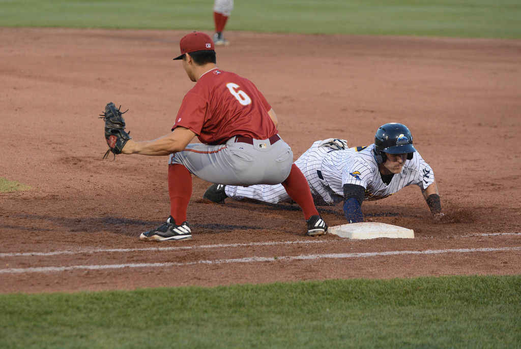 . Trenton Thunder�s Zack Zehner dives back to first as Altoona Curve�s Conner Joe tries for the pick off during Friday night�s game at Arm & Hammer Park in Trenton. 