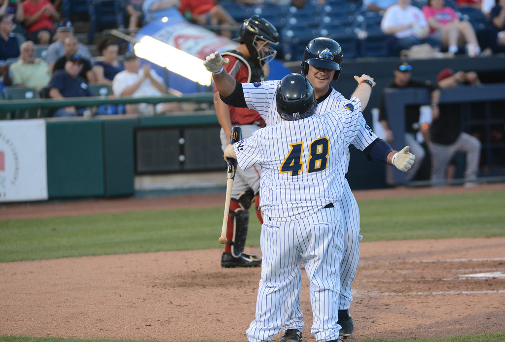 . Trenton Thunder�s Mike Ford gets a congratulatory hug from the the team�s bat boy after hitting a home run during  Friday night�s game at Arm & Hammer Park in Trenton. 