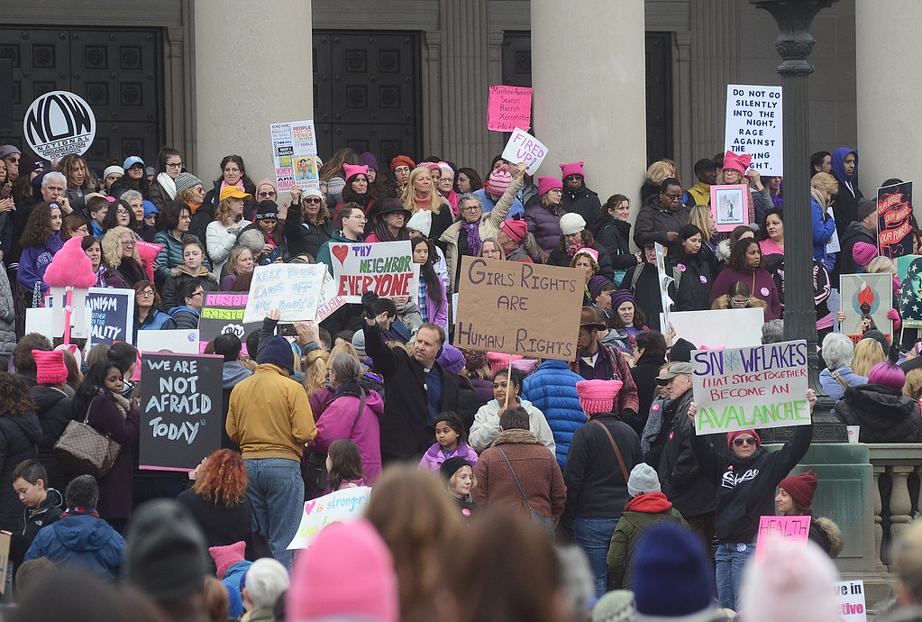 . Protesters stand on the steps of the War Memorial on Saturday morning. (Gregg Slaboda - The Trentonian)