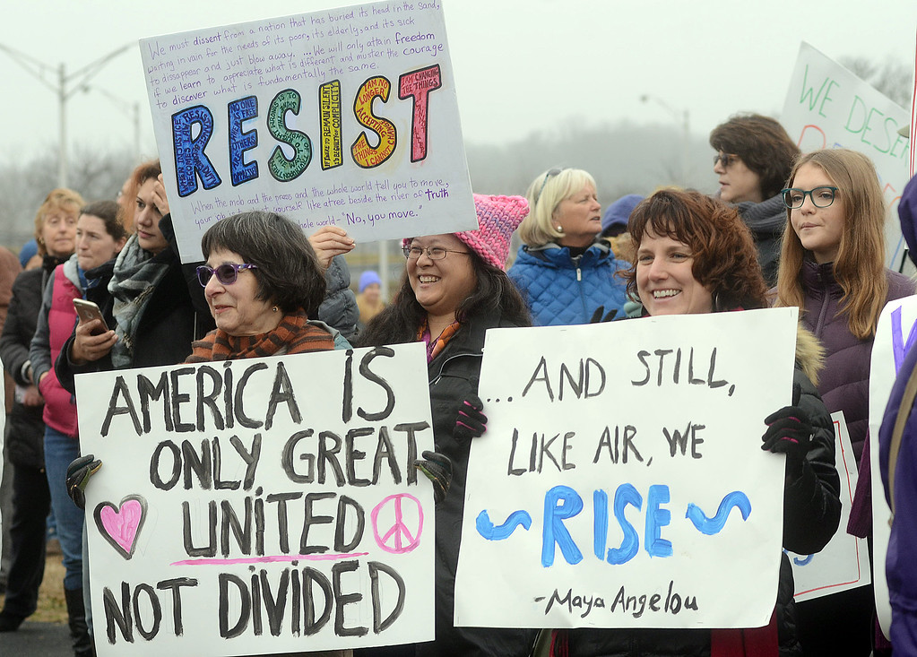 . Women hold signs at the Women`s March on New Jersey. (Gregg Slaboda - The Trentonian)