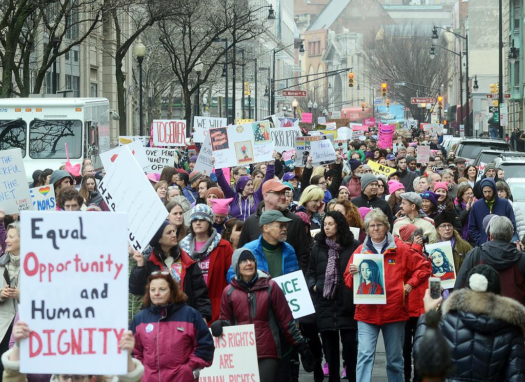 . Women`s March on New Jersey protestors walk down W. State Street in Trenton Saturday morning. (Gregg Slaboda - The Trentonian)