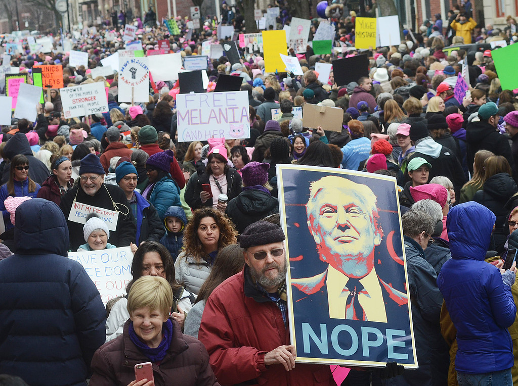 . Protestors from the Women`s March on NJ crowd West State St in front of the state house in Trenton. (Gregg Slaboda - The Trentonian)