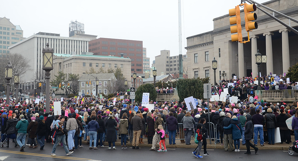 . An overflow crowd of protestors rally in front of the War Memorial. (Gregg Slaboda - The Trentonian)