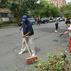 Mayoral aide Andrew Bobbitt and other volunteers clean up some debris from the 400 block of Bellevue Ave. in Trenton during part of the city's cleanup efforts Saturday. <br /> John Berry — The Trentonian