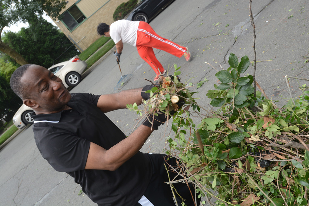 . Former mayoral candidate Walker Worthy takes part in the cleanup effort along the 400 block of Bellevue Ave. in Trenton during part of the city�s cleanup efforts Saturday. 
