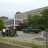 Volunteers and city workers clean up the former Mercer Hospital and much of the 400 block of Bellevue Ave. in Trenton during part of the city's cleanup efforts Saturday. <br /> John Berry — The Trentonian
