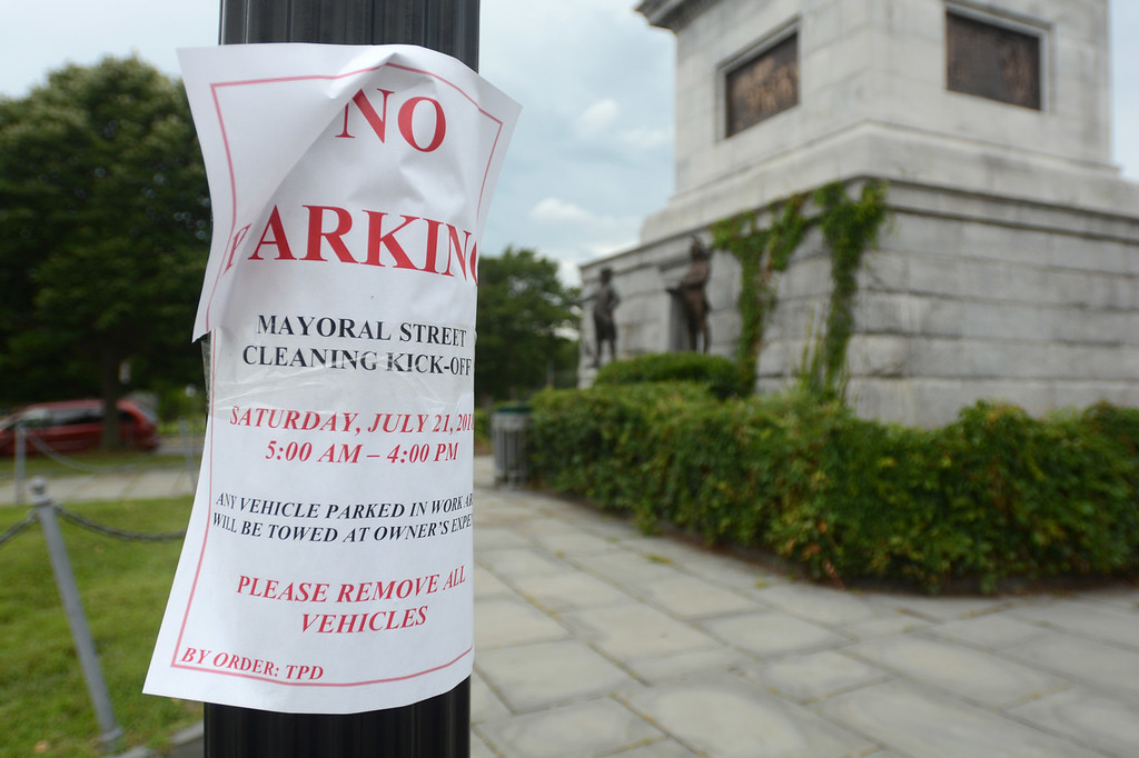 . A sign near the Trenton Battle Monument announces the planned street sweeping for Saturday. 