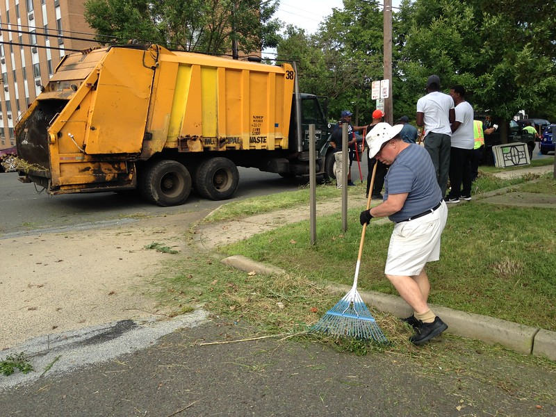 Community members and elected officials, including Mayor Reed Gusciora, participate in a cleanup initiative at the former Mercer Medical Center on the 400 block of Bellevue Avenue in Trenton on Saturday, July 21, 2018. (SULAIMAN ABDUR-RAHMAN - The Trentonian)