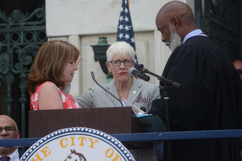 . Trenton Council Member Marge Caldwell-Wilson, center, is sworn in Sunday.  John Berry -- The Trentonian
