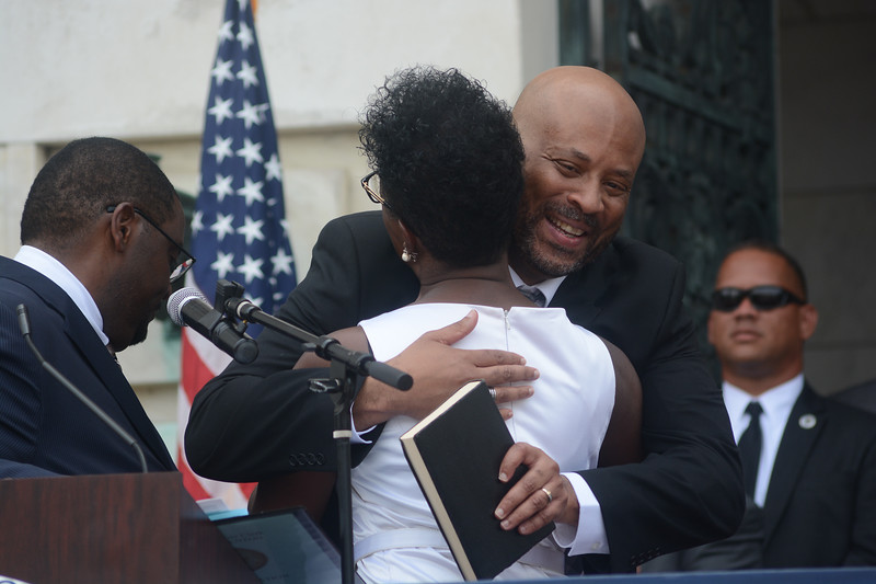 Trenton Council Member Robin Vaughn hugs her brother after being sworn in Sunday. <br /> John Berry -- The Trentonian