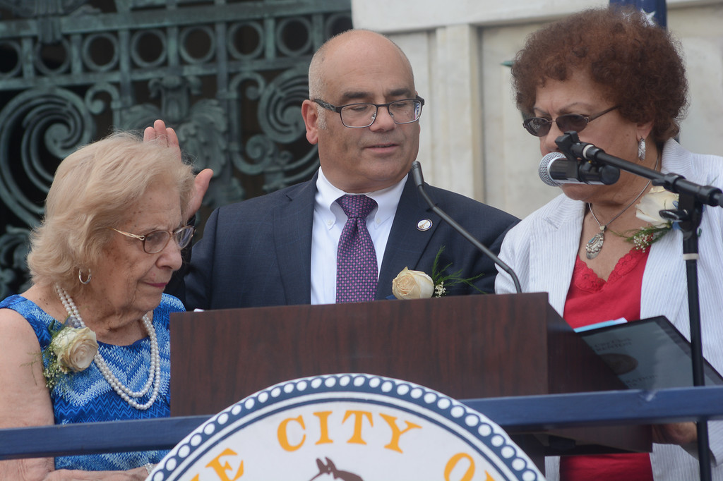 . Trenton Mayor Reed Gusciora takes the oath of office as administered by his former assembly colleague Shirley Turner.  John Berry -- The Trentonian