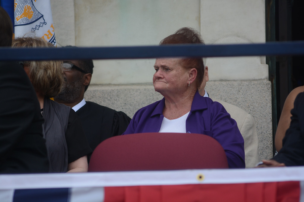 . Trenton Council Member Joe Harrison\'s mother looks on after her son is sworn in Sunday.  John Berry -- The Trentonian