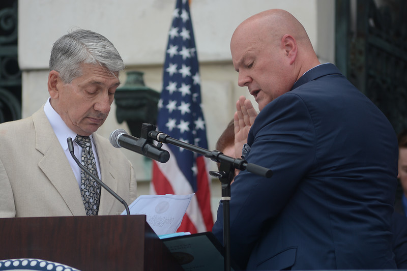 Trenton Council Member Joe Harrison is sworn in Sunday. <br /> John Berry -- The Trentonian