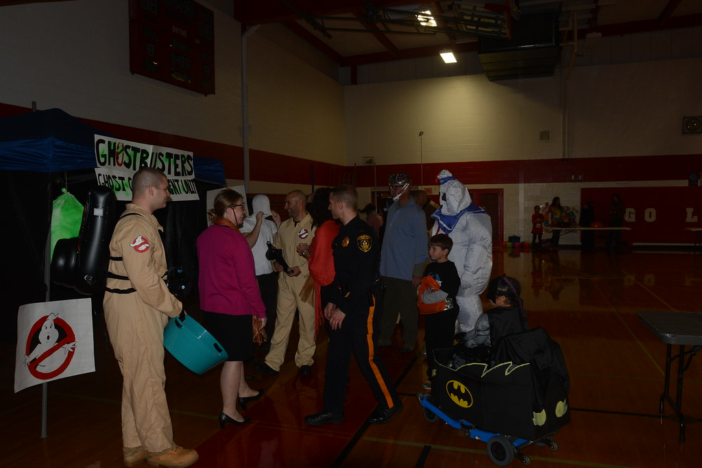 . Kids and families dress in costumes and scramble for candy as the Lawrence Township Police Department hosts its first annual Trunk or Treat pre-Halloween event at Lawrence High School on Thursday, Oct. 27, 2016. (SULAIMAN ABDUR-RAHMAN - The Trentonian)