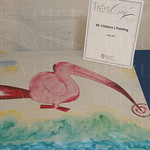 Silent auction items included this children\'s painting.