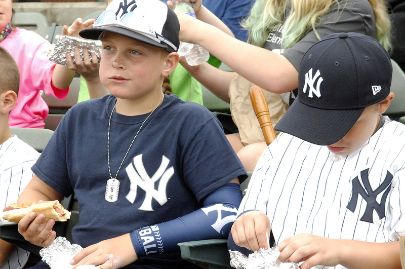 STAN HUDY - SHUDY@DIGITALFIRSTMEDIA.COM<br /> Two young Yankee fans take in a game and a couple of hot dogs at Joe Bruno Stadium during Wednesday's exhibition game between the Tri-City ValleyCats and the Albany Dutchmen.