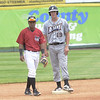STAN HUDY - SHUDY@DIGITALFIRSTMEDIA.COM<br /> Albany Dutchmen DH Cole McNamee stands at second base with Tri-City ValleyCat shortstop Juan Pineda nearby at Joe Bruno Stadium during Wednesday's annual education day exhibition game.