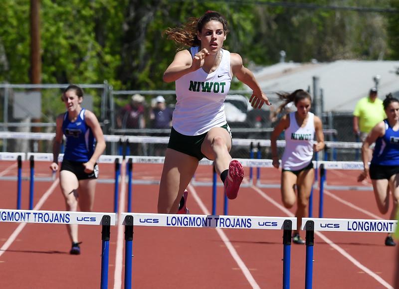 Mackenzie Fidelak, of Niwot High, wins the 300 meter hurdles at the Tri-