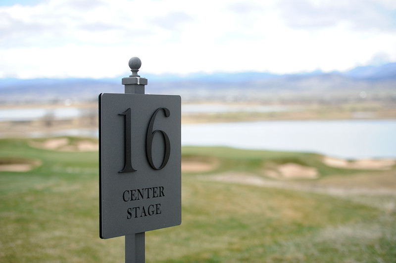 The 16th hole, Center Stage, sits behind the clubhouse and offers golfers unique views over most of the course at TPC Colorado. (Colin Barnard/Loveland Reporter-Herald)