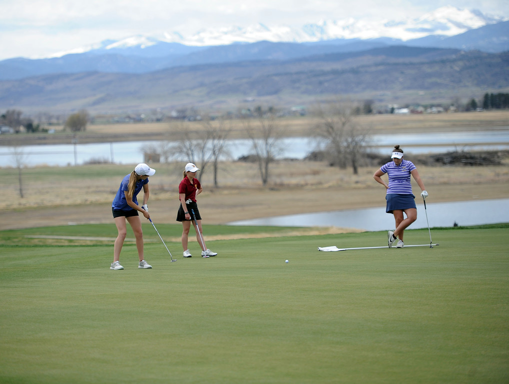 . Resurrection Christian\'s Elisabeth Perl finishes her round with a par on the 18th hole at TPC Colorado during the Tri-Valley League Meet on Monday, April 15, 2019. (Colin Barnard/Loveland Reporter-Herald)