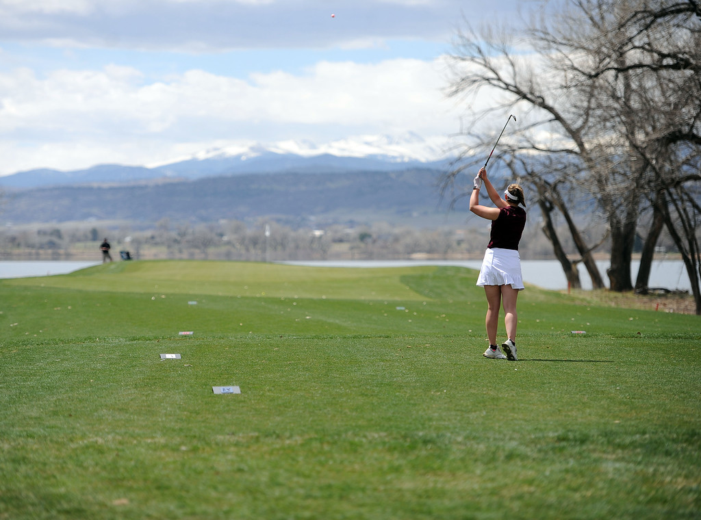 . Berthoud\'s Tatum Graham hits her tee shot on the par-3 8th hole at TPC Colorado during the Tri-Valley League Meet on Monday, April 15, 2019. (Colin Barnard/Loveland Reporter-Herald)