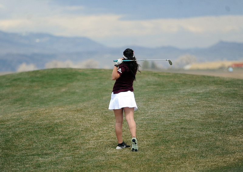 Berthoud's Cora Fate hits a ball out of the rough on the par-5 1st hole at TPC Colorado during the Tri-Valley League Meet on Monday, April 15, 2019. Fate shot a career-low 94. (Colin Barnard/Loveland Reporter-Herald)
