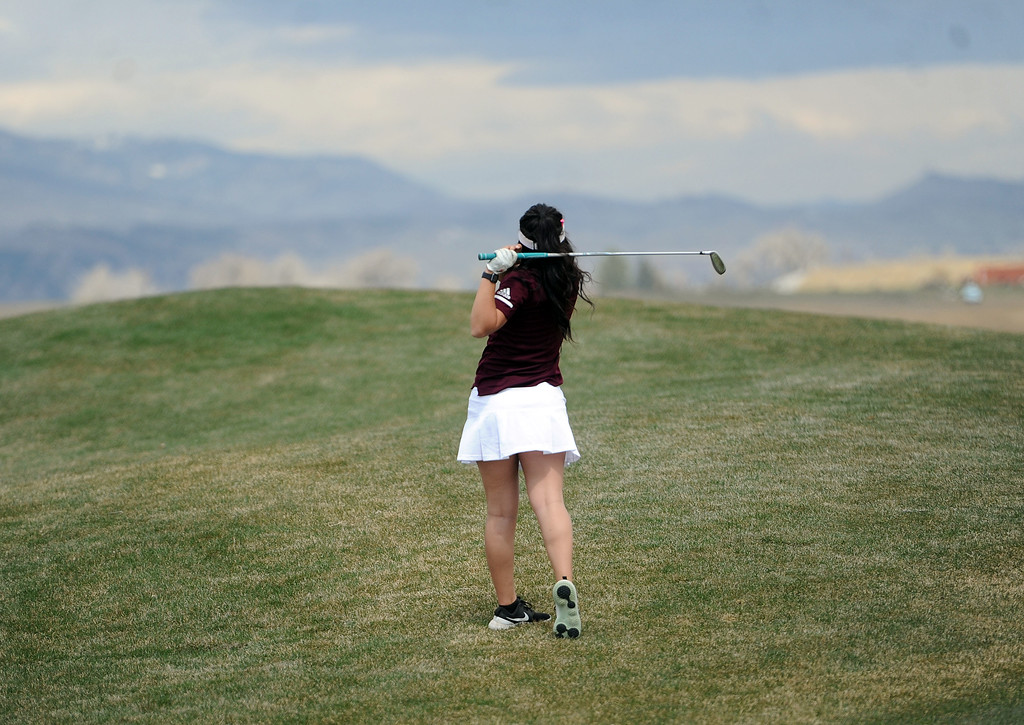 . Berthoud\'s Cora Fate hits a ball out of the rough on the par-5 1st hole at TPC Colorado during the Tri-Valley League Meet on Monday, April 15, 2019. Fate shot a career-low 94. (Colin Barnard/Loveland Reporter-Herald)