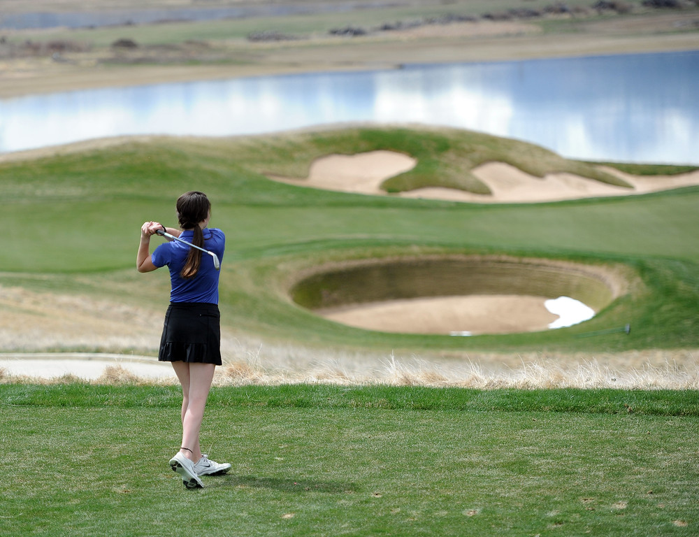 . Resurrection Christian\'s Abby McFann hits her tee shot on the par-3 16th hole at TPC Colorado during the Tri-Valley League Meet on Monday, April 15, 2019. (Colin Barnard/Loveland Reporter-Herald)