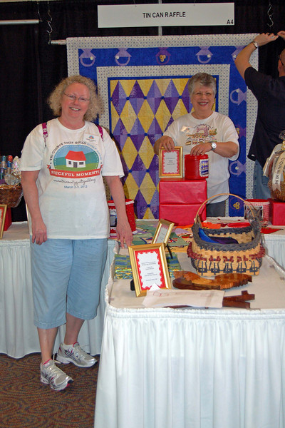 Tin Can Raffle booth being set up for the big day