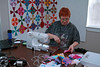 Now I know everyone knows Charmaine. Former Guild Pres.<br /> Hard at work.<br /> Can you see the while circles in her quilt on the design wall. At one point we could see a secondary colorful circle but now I don't see it. Can  you?