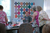 Charmaine had everyone's attention with her quilt project.