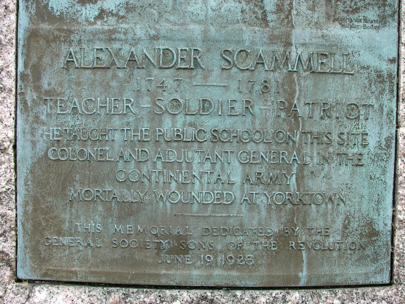 Inscription on the monument, noting that Scammell taught school on this site