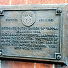 Plaque mounted on the wall of the church