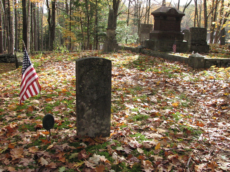 Gardner's grave has a standard Rev War marker. This view is looking toward the road.