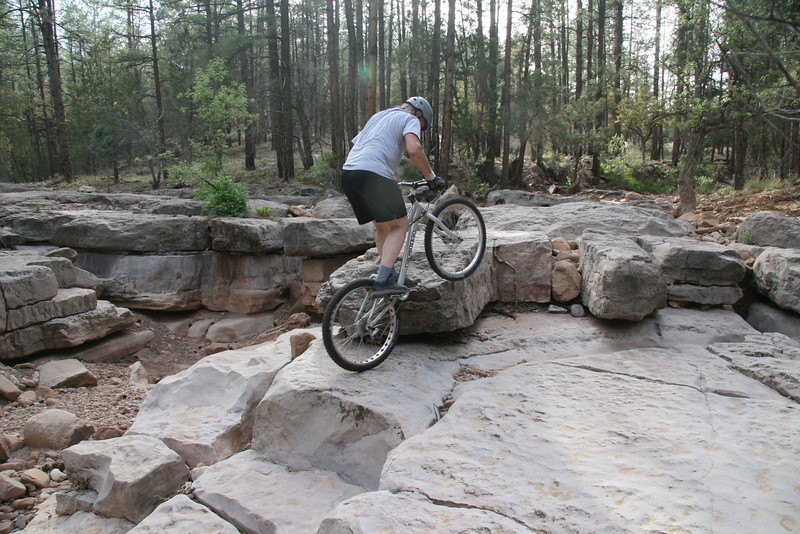 I need to lift the front wheel, move forward and swing to the left all in one complete move.